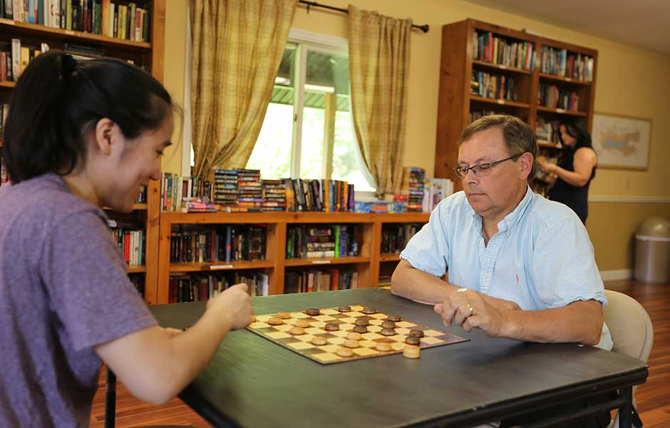 Enjoying a game of checkers is a one of many activities found at the lakeside lodge of Sleepy Hollow Lake