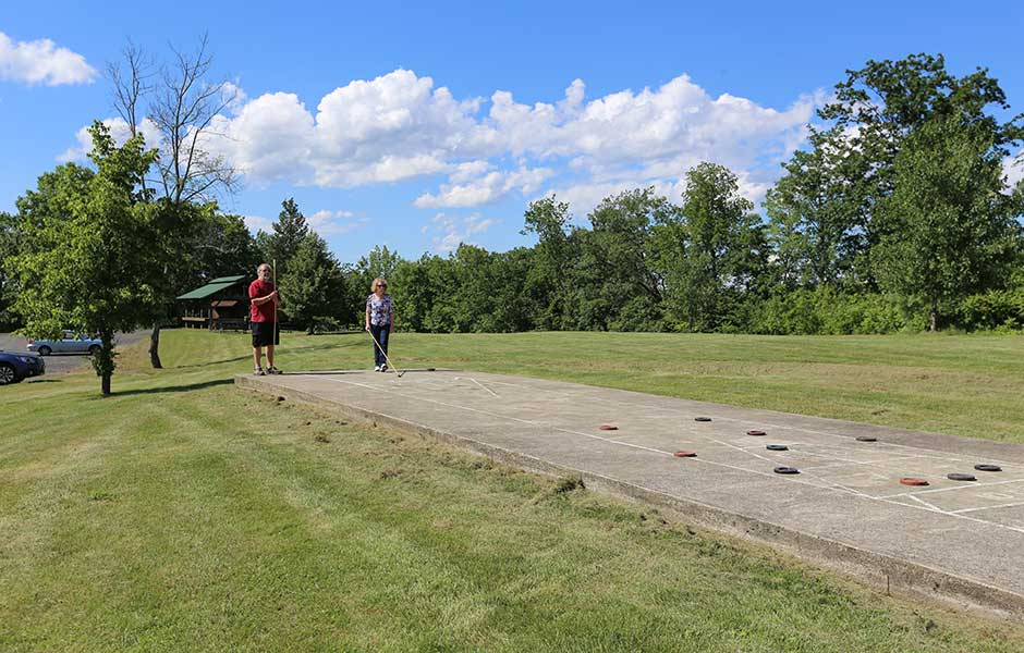 Enjoying a game of shuffle board is a one of many activities found at Sleepy Hollow Lake