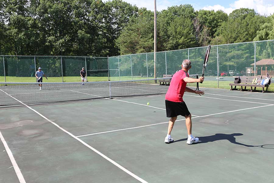 Playing tennis on the Lighted Tennis Courts at Sleepy Hollow Lake