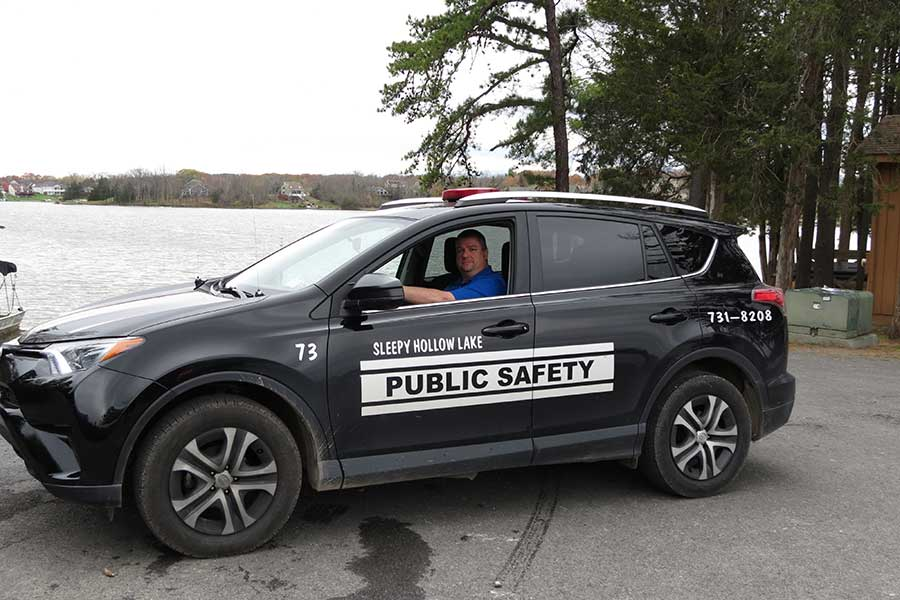 Well marked public safety vehicles patrol the sleepy hollow lake community in Athens NY