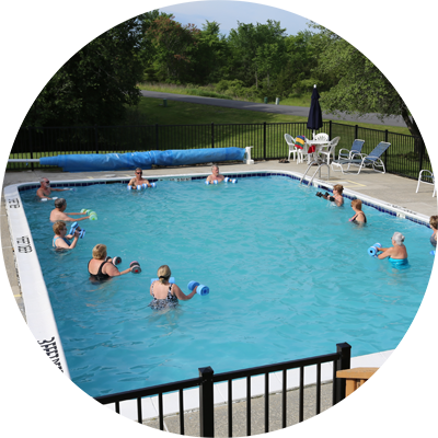 Enjoying the pool is part of your lakefront lifestyle on Sleepy Hollow Lake in Athens, NY